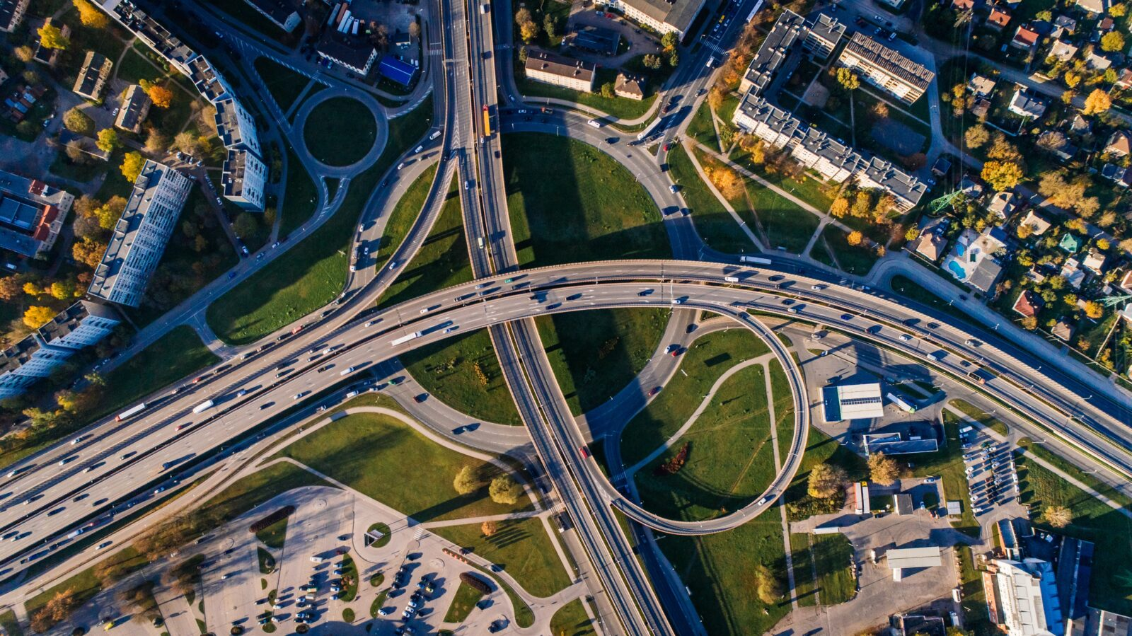 Aerial photo of traffic on overpasses above an interstate interchange.